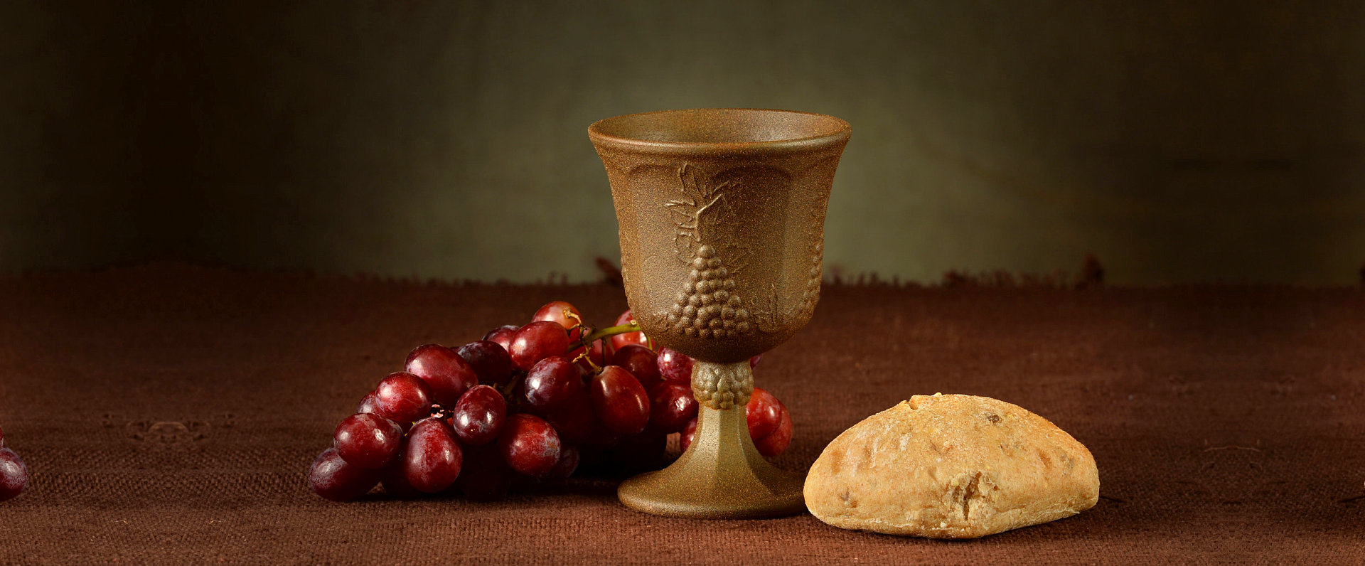 bread, cup, and grapes