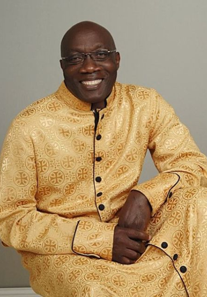 man wearing eyeglass smiling
